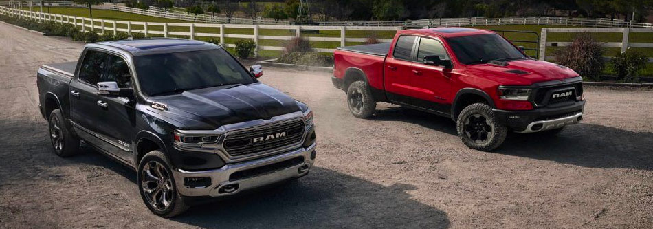 two ram trucks on dirt road