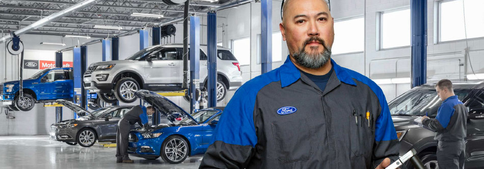 ford auto shop service center with a ford auto mechanic in the front