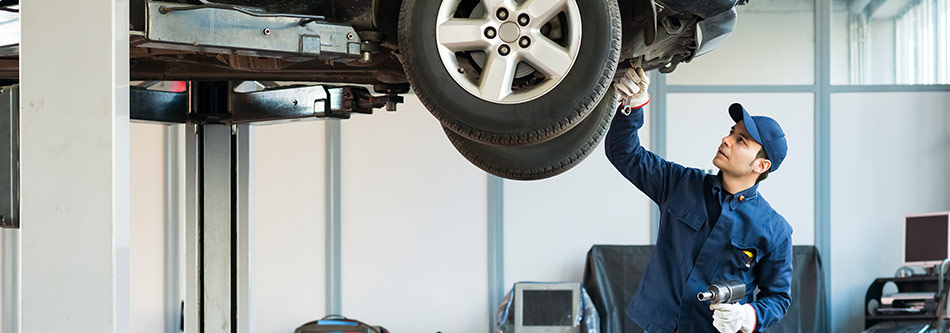 auto mechanic inspecting mini brakes