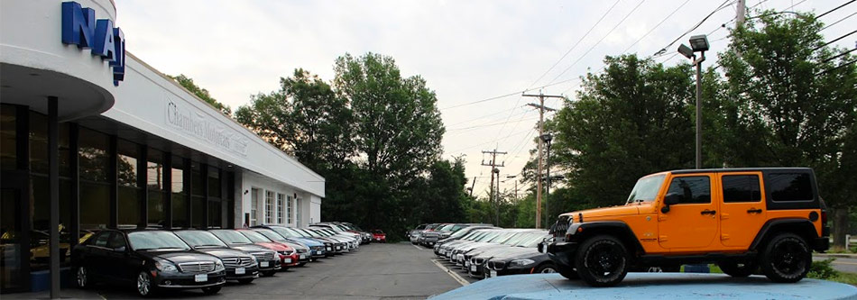 chambers motorcars dealership with a lot of vehicles in front of it